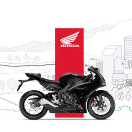 Side facing Honda motorcycle with test ride illustration.