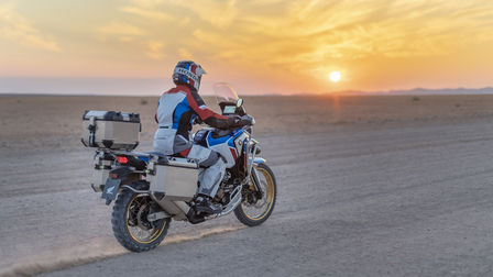 Africa Twin Adventure  with rider and sunset